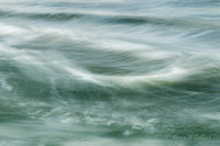 Deep green waters with white frothy tops in slow motion